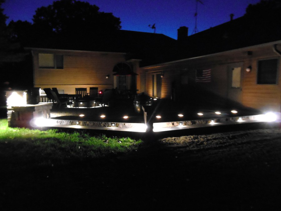 Youngbauer landscaping landscape lighting outdoor kitchens fire accent lighting around a paverstone patio aloadofball Choice Image